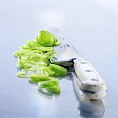 Leek rings and a kitchen knife