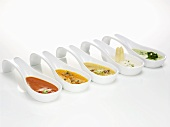 Various sauces on spoons