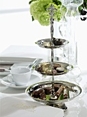 A cake stand with various pralines