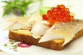 Toast with trout fillet and caviar