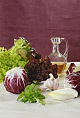 Radicchio, chicory and lettuce with garlic, vinegar and bunch of herbs