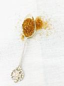 Demerara sugar on silver spoon