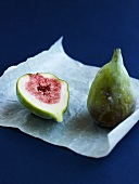 Whole fig and half a fig on parchment paper