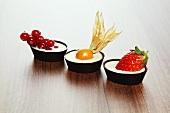 Three chocolate fruit tarts