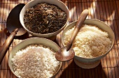 Three different types of rice in bowls