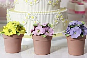 Wedding cake and artificial pansies