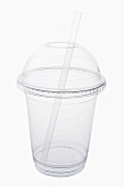 Plastic cup with straw for drinks