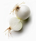 Whole white onion and half an onion