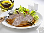 Stuffed breast of veal with salad
