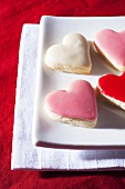 Iced heart-shaped biscuits on plate