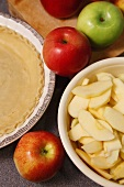 Whole and Sliced Apples with Pie Crust for Baking