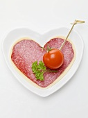 Salami and cheese heart with cherry tomato