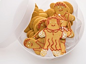 Gingerbread people in storage container