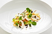Salad of mushrooms, carrots, corn salad and pumpkin seeds