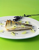 Fried zander with lavender flowers and lime segments