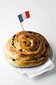 Raisin roll with French flag
