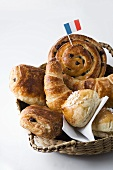 Sweet pastries with French flag in bread basket