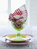 Dessert glass with a serviette and a plate