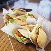 Smoked salmon, goat's cheese and tomato sandwiches