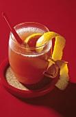 Orange punch garnished with orange peel
