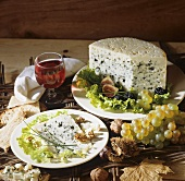 Autumn still life with Roquefort, wine and fruit