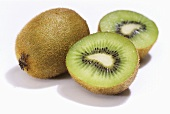 Kiwi fruit, one whole and one halved