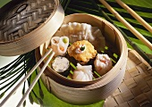Assorted dim sum in a steaming basket