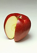 A red apple with a section cut out