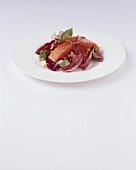 Poached salmon on radicchio salad