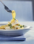 Thin ribbon pasta with cream sauce and mint