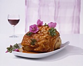 Roast pork with crackling and edible flowers