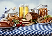 Bavarian sausages with beer on tablecloth