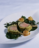 Lamb chops in herb crust with onions
