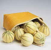 Charentais melons in and spilling out of bag
