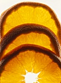 Three slices of orange, backlit