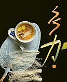 Asian soup with glass noodles and egg