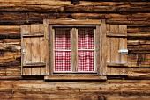 Window in a wooden hut