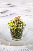 Glass of moss with Easter lamb on plate