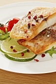 Fried tilapia fillets with red peppercorns and lime