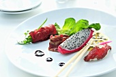 Appetiser plate with beef and pitahaya appetisers