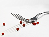 Pink peppercorns and a fork