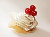 Brigidino (aniseed wafer, Tuscany) with whipped cream and redcurrants