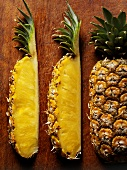 Wedges of pineapple on wooden background
