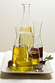 Various types of oil in carafes