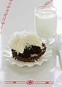Chocolate Cupcake with Coconut; Bitten; Glass of Milk