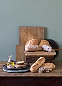 Rustic Loaves of Bread on Wooden Table with Spreads