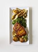 Pan Fried Fish with Veggies on a White Rectangular Dish