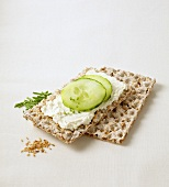 Sesame crispbread with soft cheese, cucumber and chives