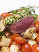 Beef sirloin with herb crust on bed of vegetables