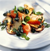 Salmon with fried cep mushrooms and clover